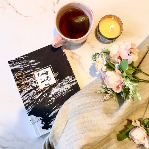 2021 diary on desk with cup of tea