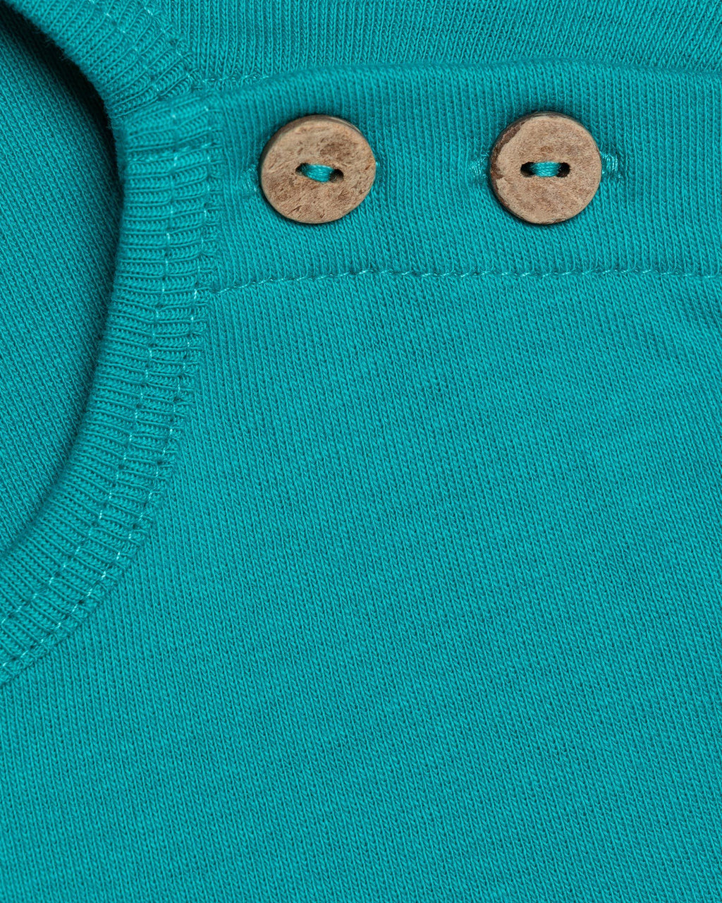 variant_1 | EN Organic Green basic longsleeve sweater with buttons on shoulder for babies | DE Bio Grüner langarmliger sweater für babies  mit Knöpfen auf der Shulter