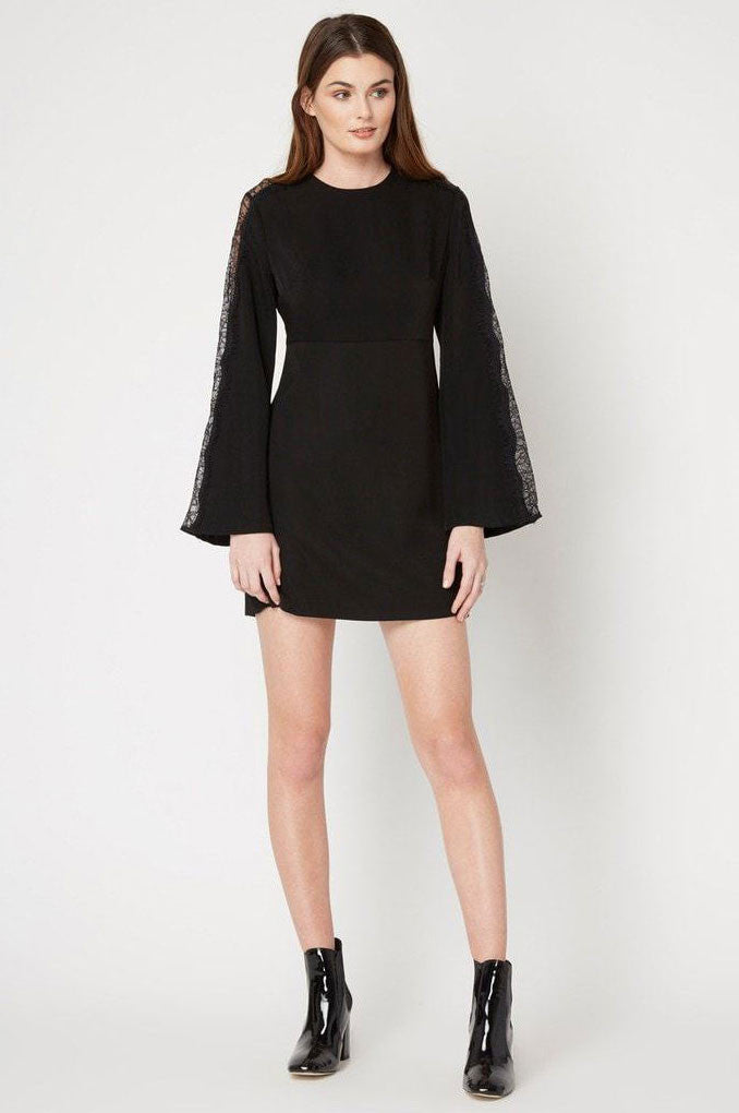 Women's black long sleeve mini party dress with lace inset.