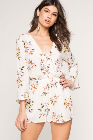 Women's long sleeve white floral print romper playsuit.