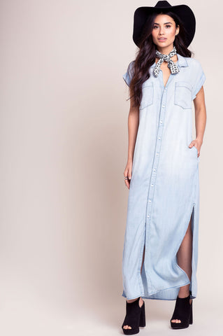 Women's short sleeve long chambray dress with button down front. Light blue shirtdress with slits.