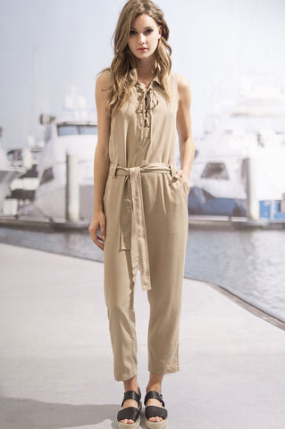 Women's sleeveless deep v-neck lace up khaki jumpsuit with drawstring belted waist.