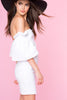 Womens street style casual outfit ideas: White off the shoulder bodycon mini party dress. Front view.