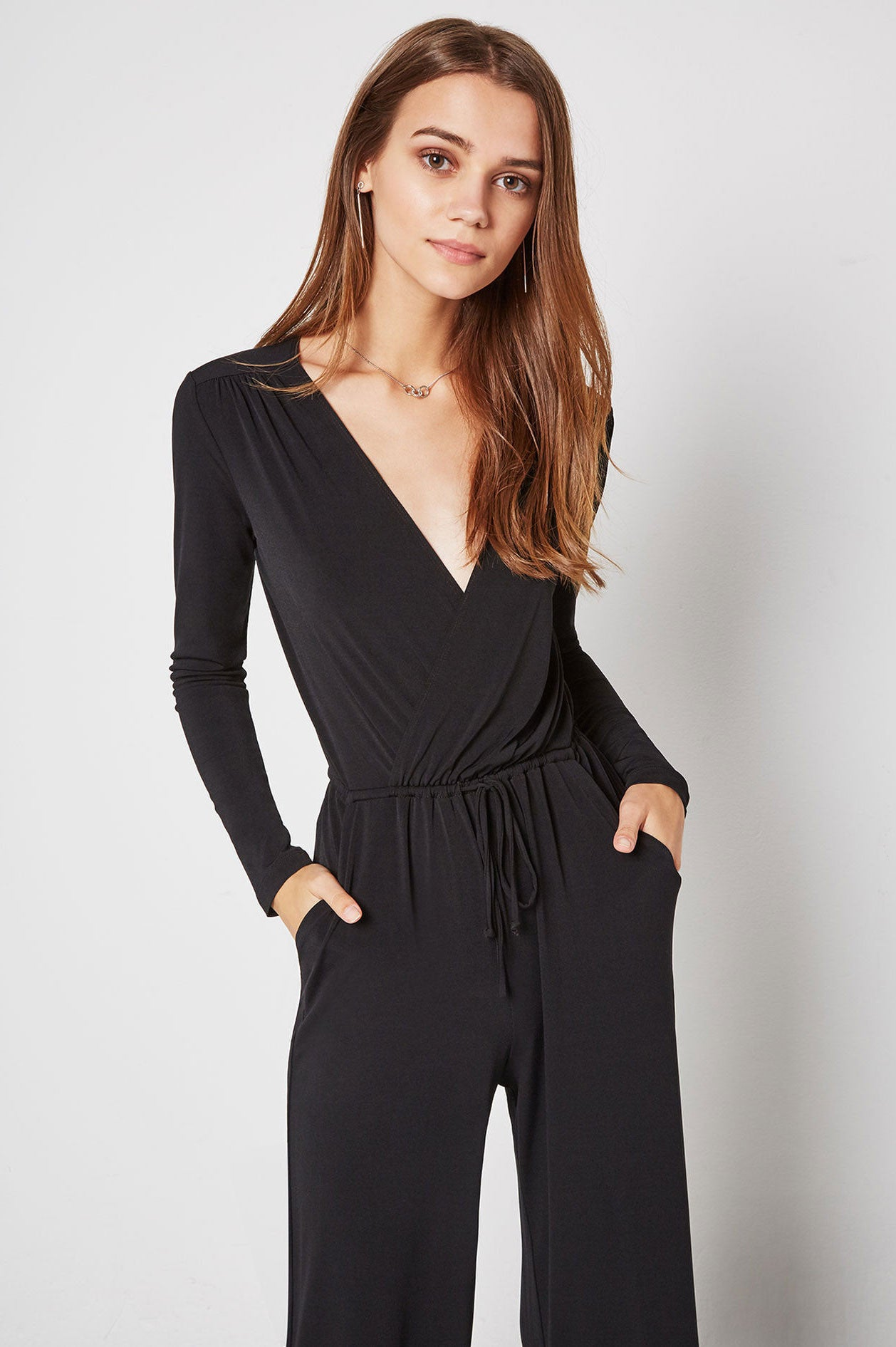 Outfit idea: Women's long sleeve faux wrap v-neck jumpsuit with wide legs.