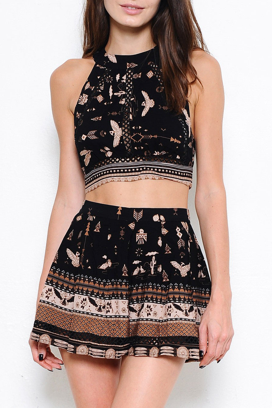 Women's casual crop top outfits: black border print tribal two piece matching set with shorts. Front view.