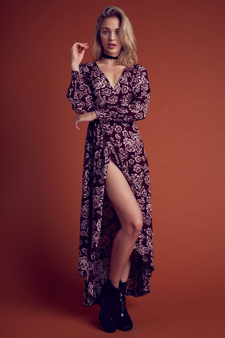 Womens long sleeve floral print wrap maxi dress in burgundy. Front view.
