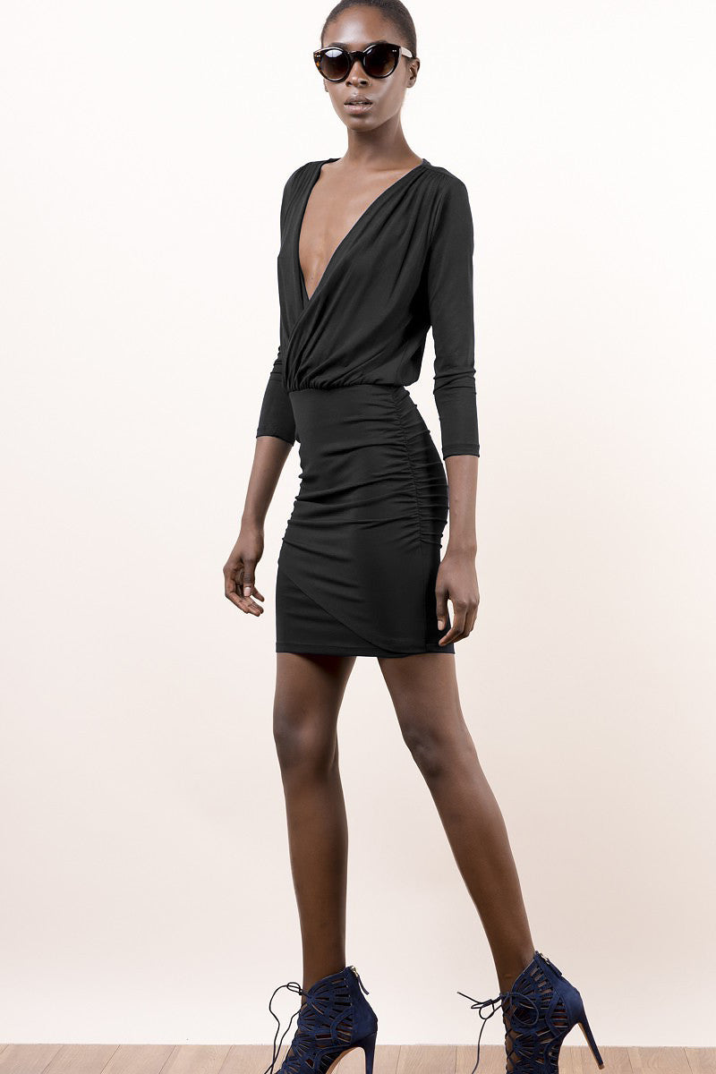 Womens Street Style Outfit: Black 3/4 sleeve deep v neck jersey party dress, mini. Front view