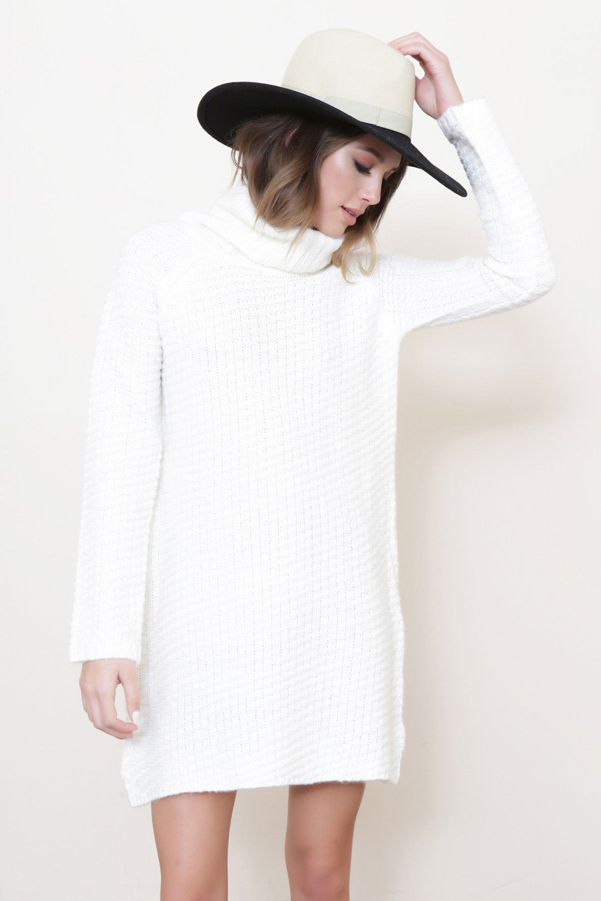 Long Sleeve cable knit, waffle knit mini sweater dress in ivory white. Front view