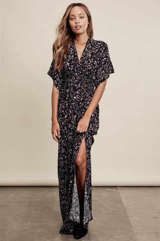Women's boho dresses outfits: black floral print boho maxi dress and long kimono kaftan dress with side slits. Front view.