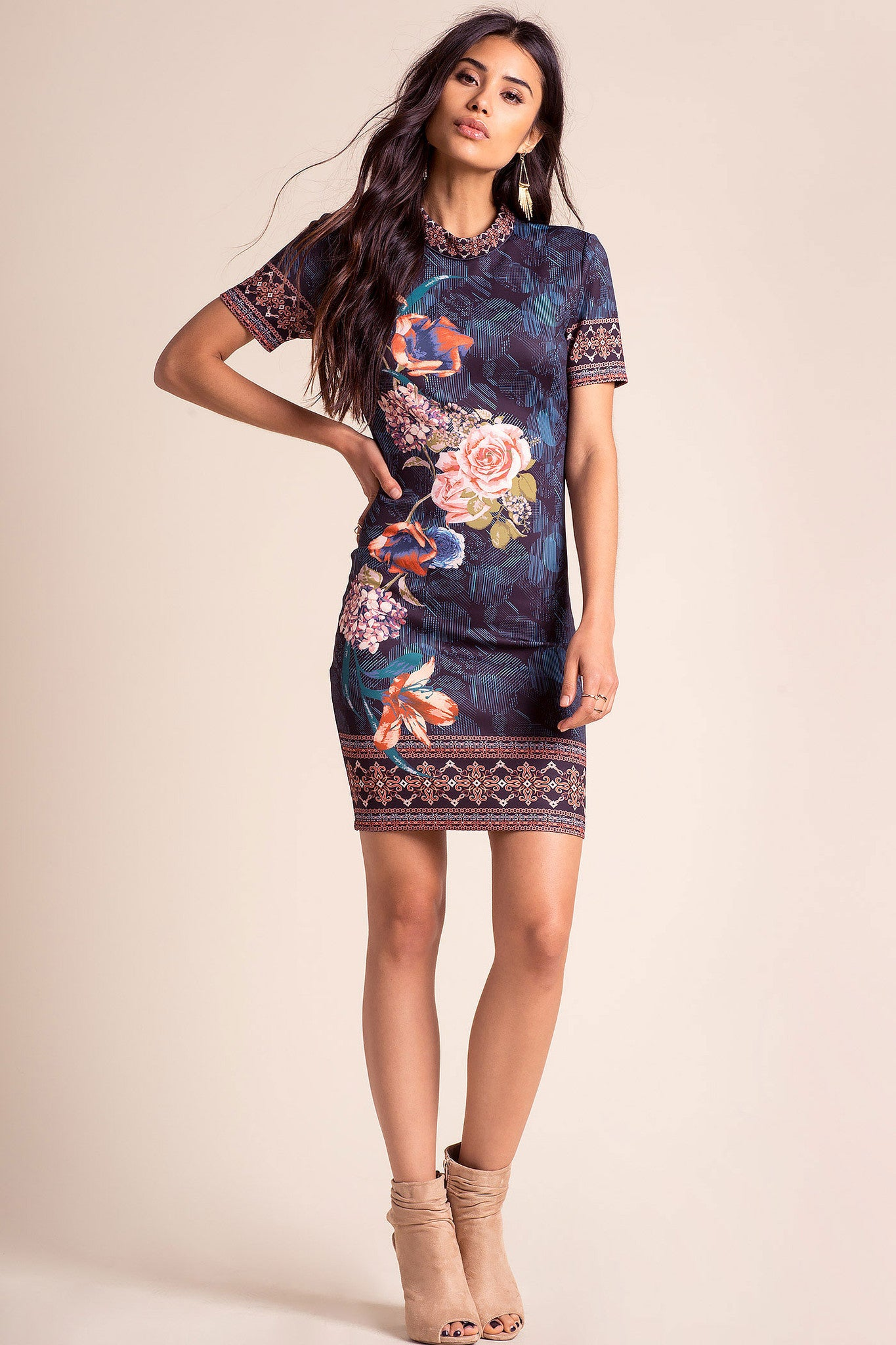 women's short sleeve navy blue floral print bodycon mini party dress. Front view.