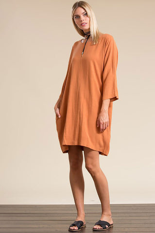 Women's round neck 3/4 long sleeve oversized mini shift tunic dress with pockets in apricot neutral