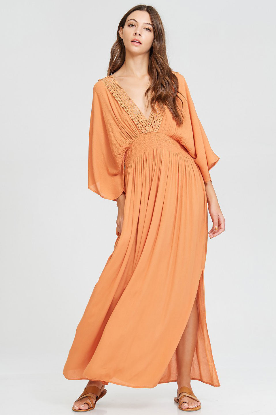 Women's deep v-neck 3/4 draped kimono sleeve long casual maxi dress for summer. Crochet lace trim with side slits. Apricot orange