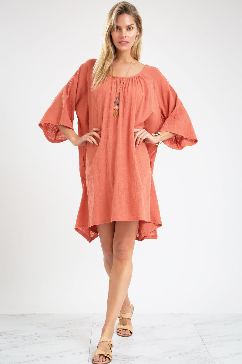 Women's 3/4 elbow length mini flare casual day dress. Oversized tunic dress in apricot.