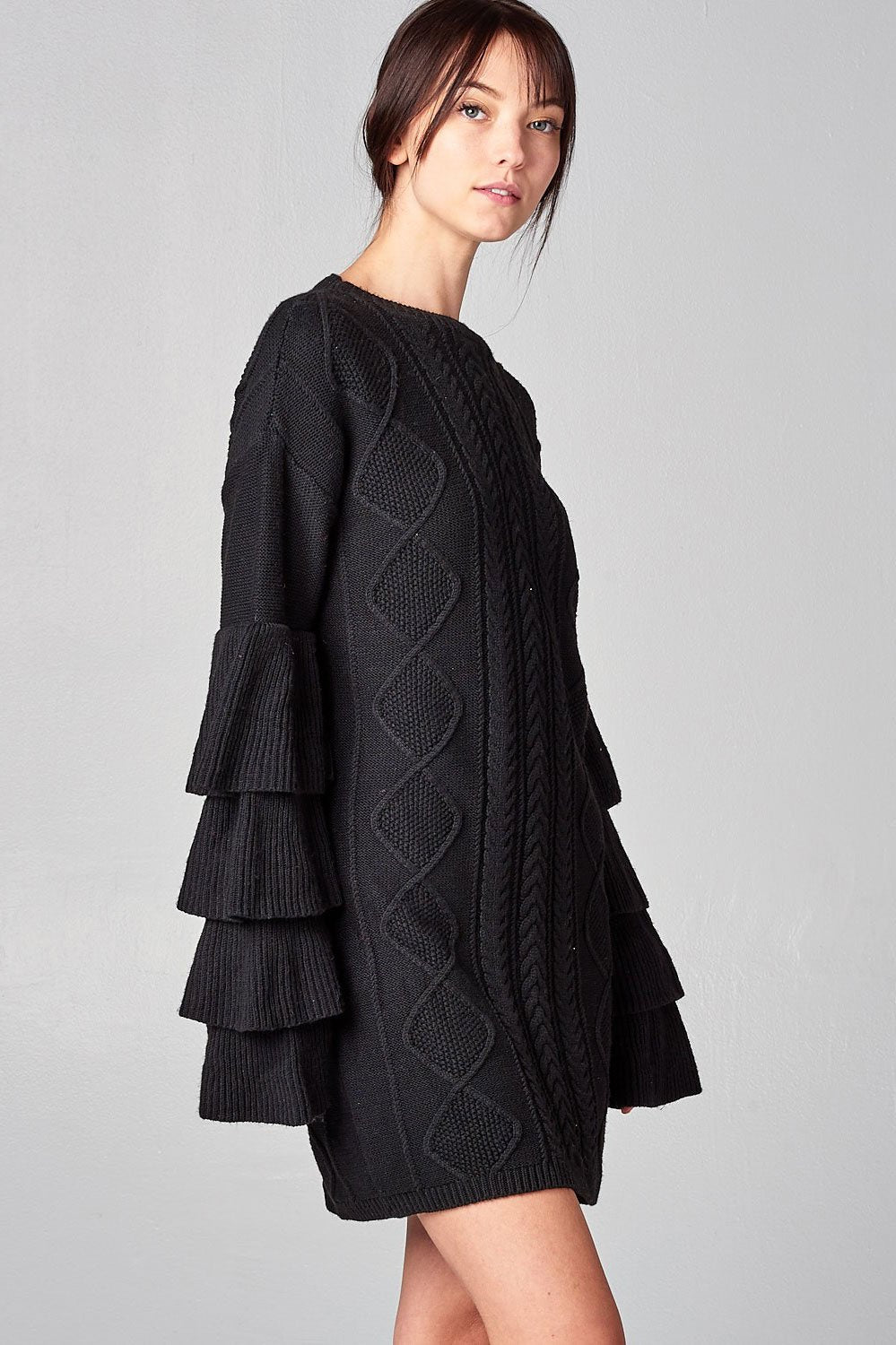 women's black cableknit mini sweater dress with layered long sleeves.