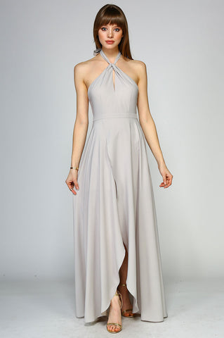 Women's sleeveless halterneck long maxi dress with slit. Twist neck party dress for wedding guest attire.