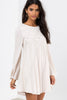 White street style long sleeve lace overlay shift dress. Front view