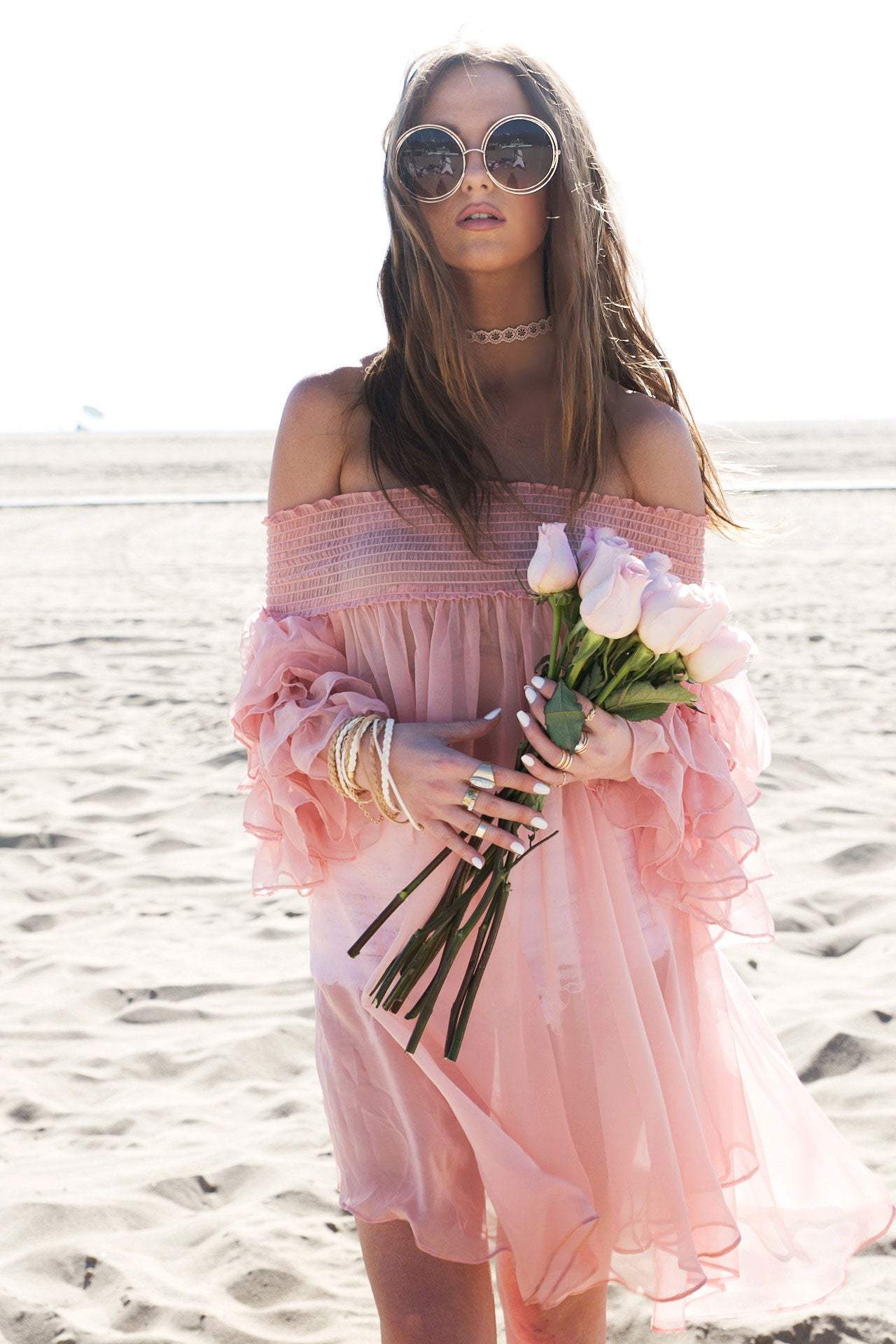 Off the shoulder sheer ruffle resort wear cover-up dress in pink. Front view