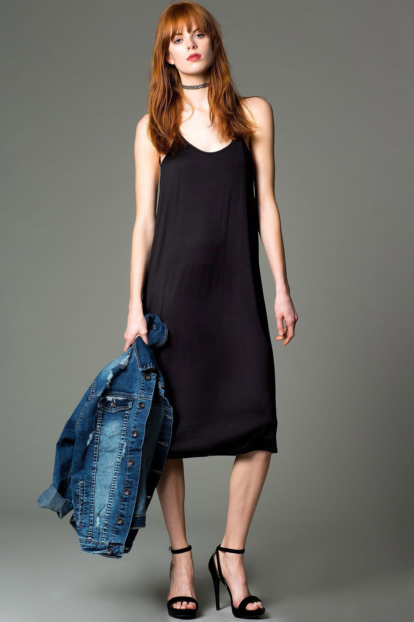 Womens casual street style oufit idea: Athleisure Sleeveless cami slip dress in black. Front view