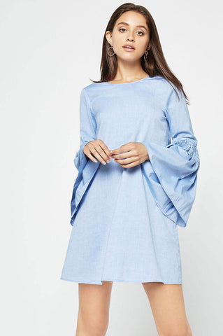 Women's light blue chambray long bell sleeve mini shift casual day dress for autumn fall outfits.