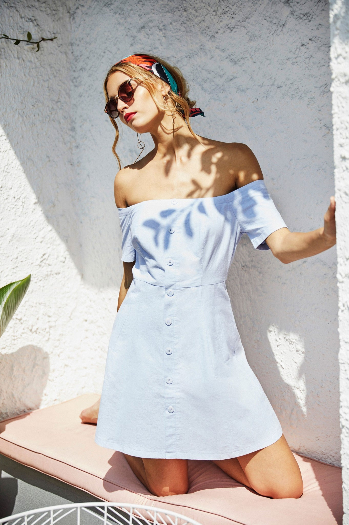 Women's light blue off the shoulder pinafore casual mini dress.