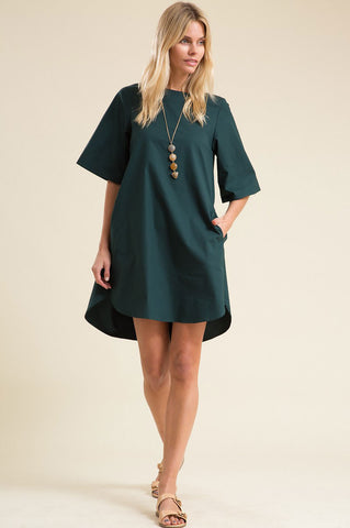 Women's short sleeve mini tunic shift dress. Cute casual summer outfit. Green