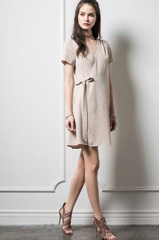 Women's short sleeve v-neck mini wrap dress. Neutral taupe, oversized loose relaxed fit