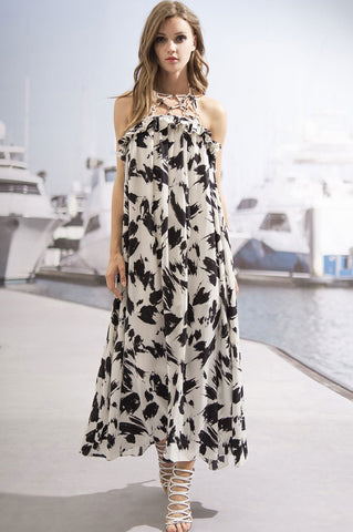 Women's sleeveless halter neck black and white print trapeze tent maxi dress. Party summer outfit.