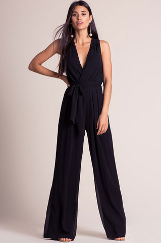 Women's sleeveless deep v-neck surplice wide leg palazzo jumpsuit for going out. Cute autumn fall outfit. Black