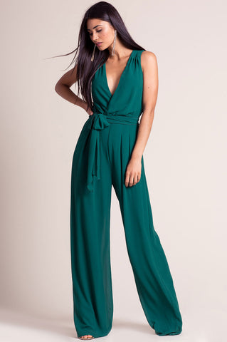 Women's sleeveless deep v-neck surplice wide leg palazzo jumpsuit for going out. Cute autumn fall outfit. Green