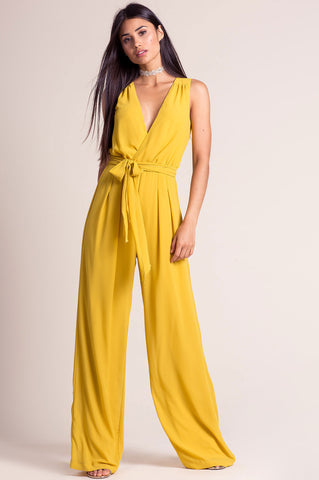 Women's sleeveless deep v-neck surplice wide leg palazzo jumpsuit for going out. Cute autumn fall outfit. Mustard yellow