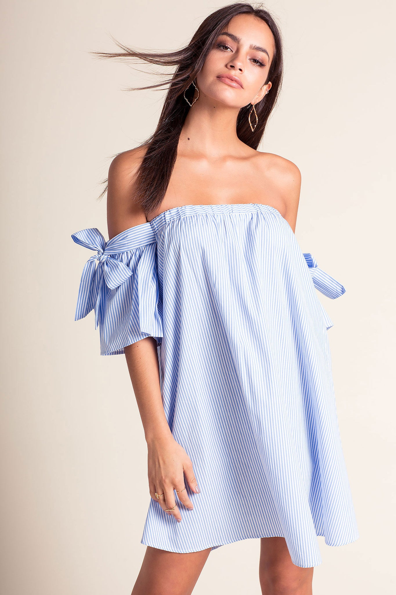 Women's off the shoulder short sleeve light blue and white pinstripe mini shift casual day dress.