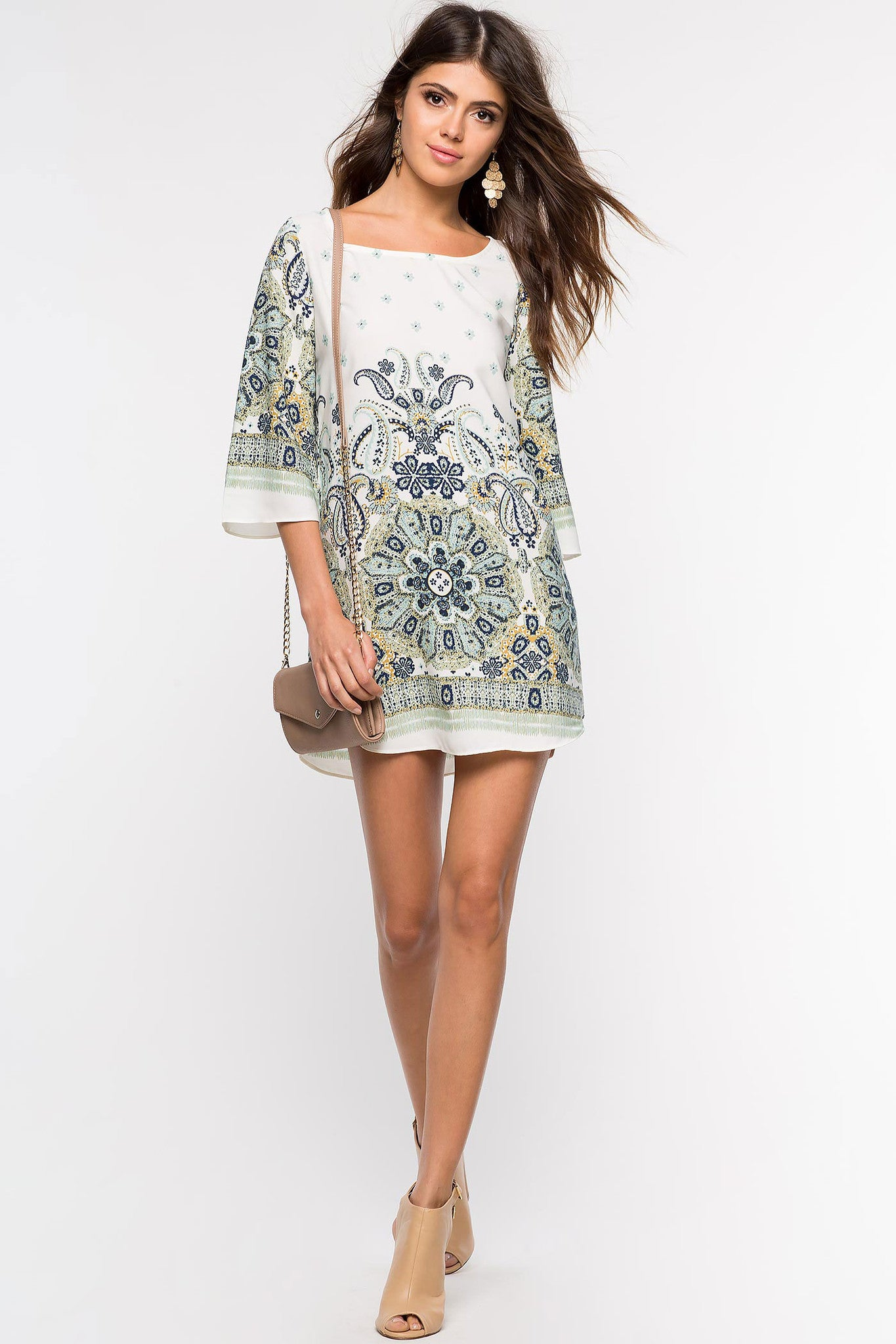 Womens Casual street style outfit long sleeve paisley print mini shift tunic dress in green print. Front view