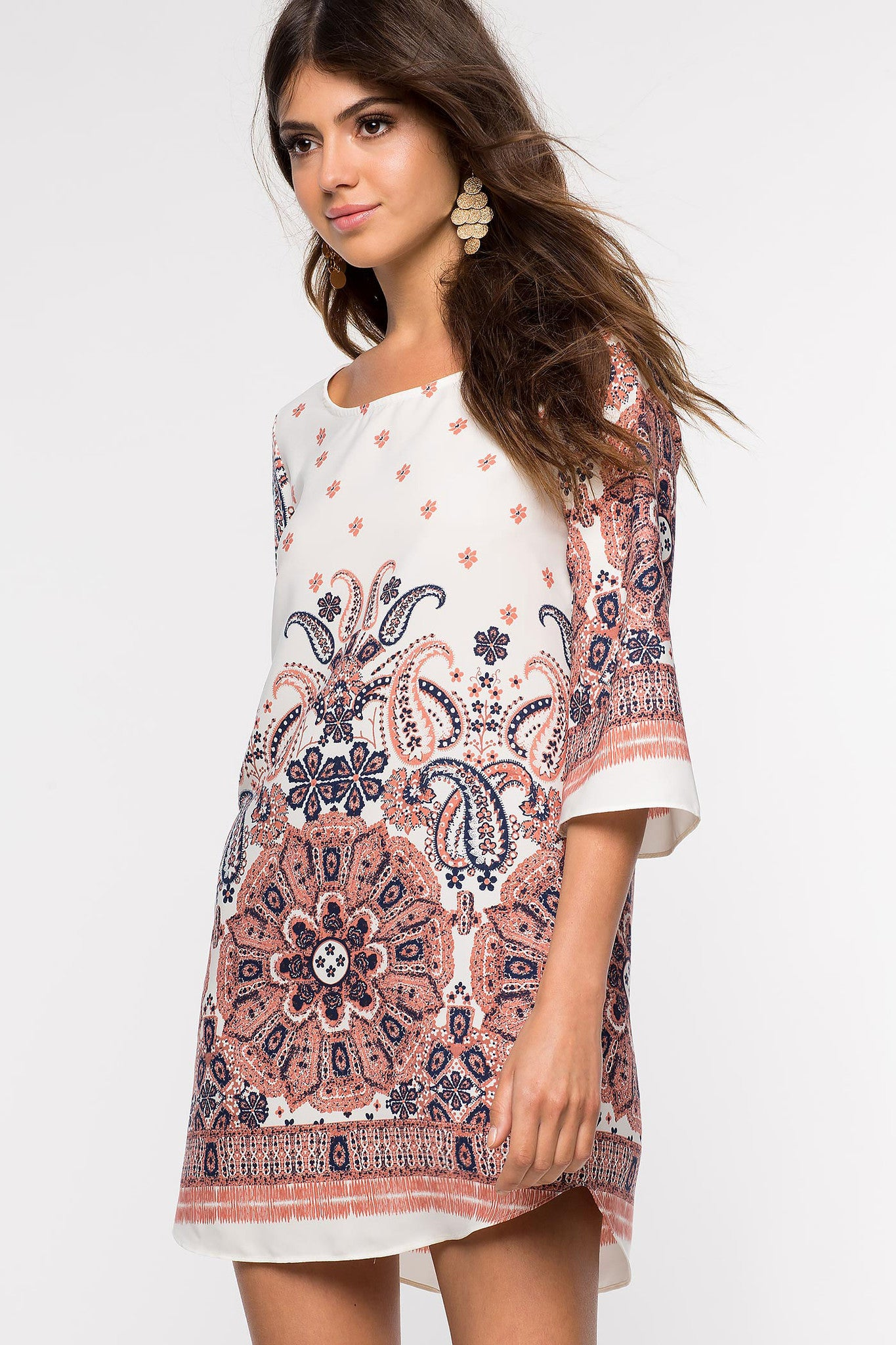 Womens Casual street style outfit long sleeve paisley print mini shift tunic dress in red coral print. Front view