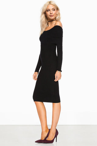 women's off the shoulder long sleeve bodycon midi ribbed sweater dress in black. Front view.