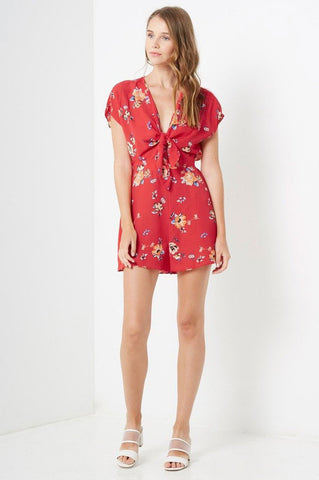 Women's short sleeve red floral print casual romper playsuit with tie front.
