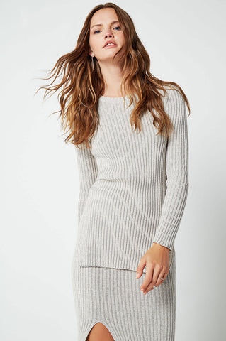 Women's matching two piece outfit with ribbed sweater top and skirt. Grey co-ords