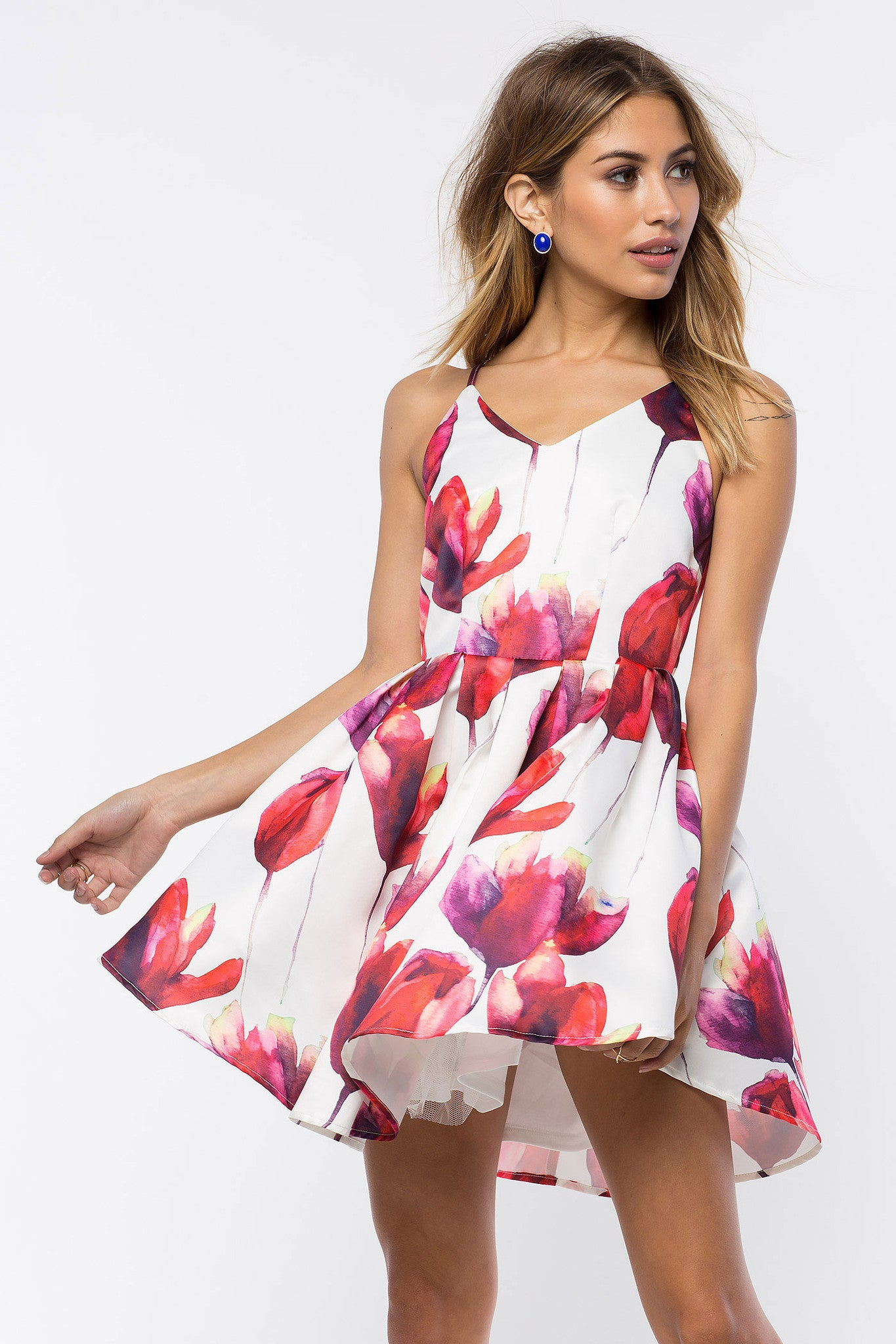 Spaghetti strap red floral print fit and flare skater party dress white. Front view