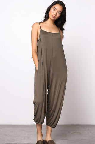 Women's olive green casual sleeveless spaghetti strap jersey oversized loose fit jumpsuit with pockets.