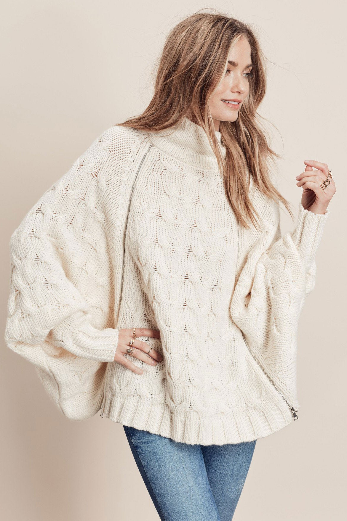 Women's long dolman sleeve chuncky knit sweater in cream. Oversized sweater. Cute fall outfits