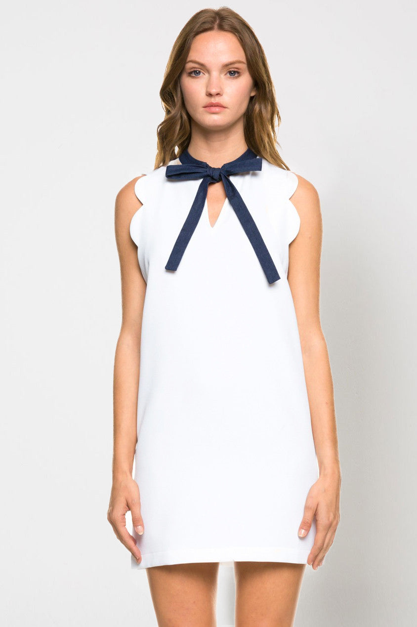 women's sleeveless scallop white dress with navy blue contrast bow-tie. Going out cocktail party dress.