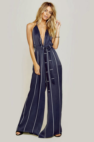Women's sleeveless plunging deep v-neck navy blue belted stripe wide leg jumpsuit for going out.