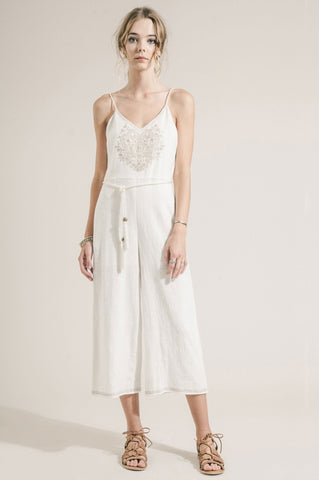 Women's sleeveless white linen jumpsuit with embroidery detail. Cropped leg jumpsuit