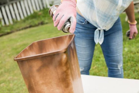 Spray painting a trash can