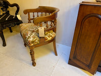 Antique French walnut framed upholstered tub armchair