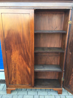 Brown Cupboard with open door revealing shelves