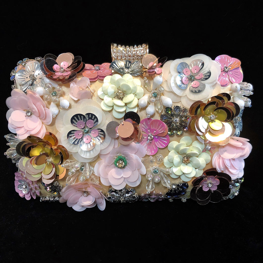 A PINK FLOWER ENCRUSTED EVENING PURSE