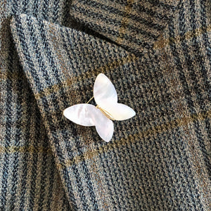 A MOTHER OF PEARL PETITE BUTTERFLY BROOCH