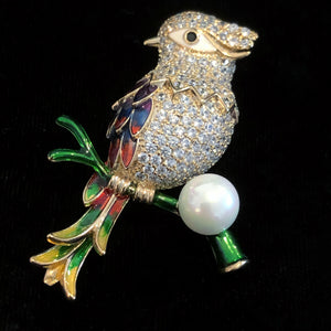 A CUCKOO WITH SINGLE PEARL BROOCH