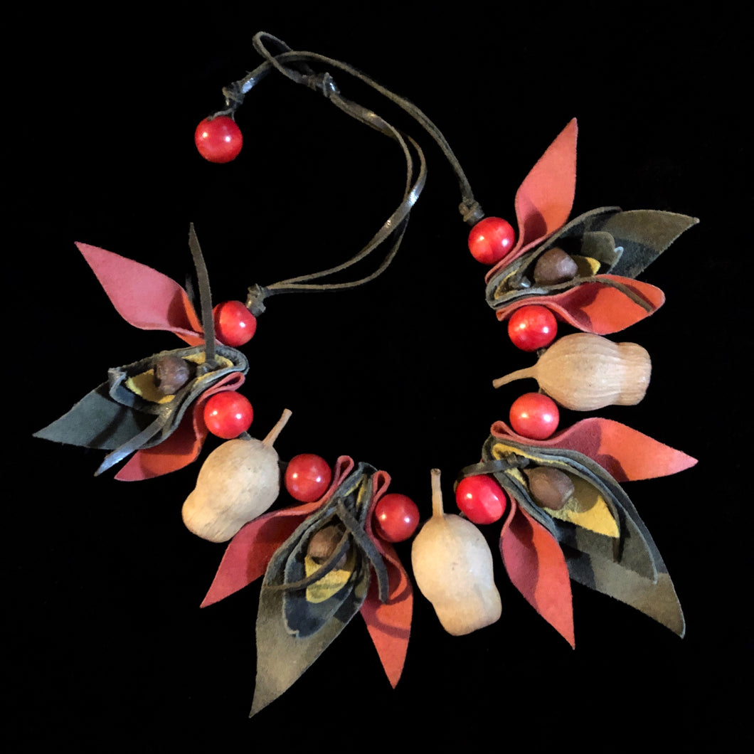 AN 80s GUM NUT NECKLACE WITH RED BEADS
