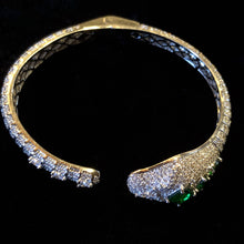 Load image into Gallery viewer, A DIAMANTÉ SNAKE BRACELET WITH GREEN JEWELS